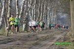 1e kilometer, links in achtervolgend groepje